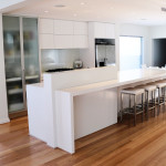 Sleek white modern kitchen by ARTRA, Central Wheatbelt Western Australia